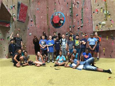 The BLOCK outreach at a rock wall climbing event