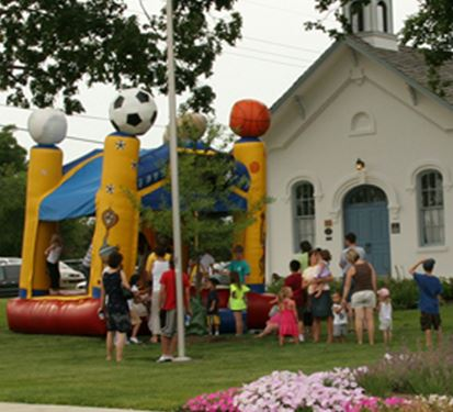 Bounce house in front of a church